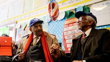 Tuskegee Airmen members Dabney Montgomery, left, and Wilfred