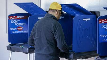 A man casts his ballot in the