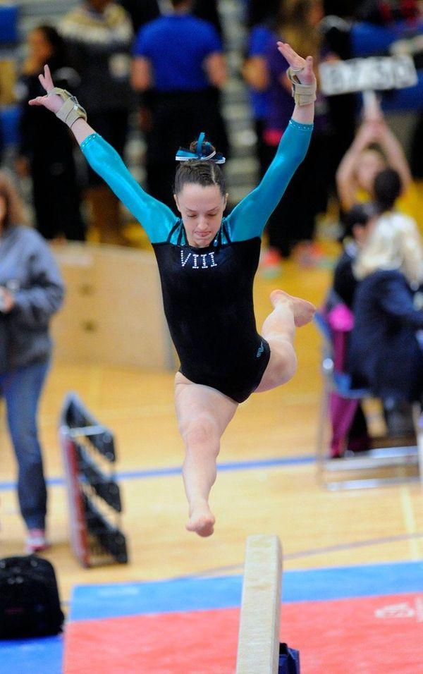 Plainview JFK's Miranda Lund performs on the balance