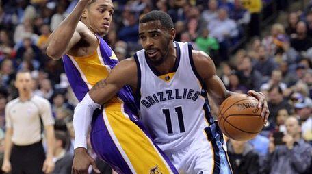 Memphis Grizzlies guard Mike Conley (11) drives