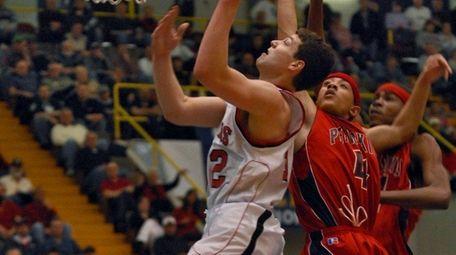 Glens Falls High School's Jimmer Fredette puts up