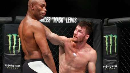 Michael Bisping of knocks out the gumshield of