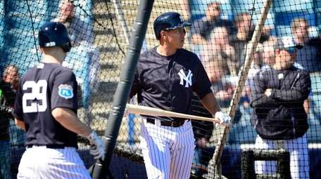 Alex Rodriguez takes batting practice during Spring