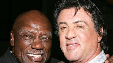 Actors Tony Burton and Sylvester Stallone pose at