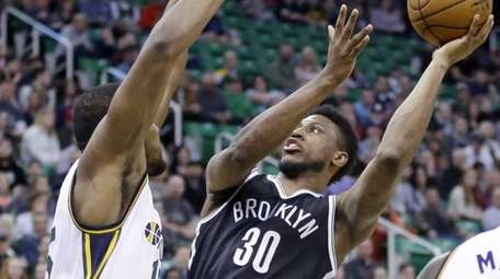 Brooklyn Nets forward Thaddeus Young (30) shoots as