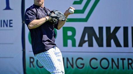 New York Yankees Brett Gardner fields fly balls