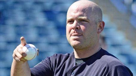 New York Yankees' Brian McCann looks on during