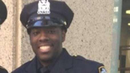 NYPD officer Vincent Harrison, right, is seen with