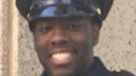 NYPD Officer Vincent Harrison, right, of Valley Stream,