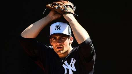 Yankees starting pitcher Nathan Eovaldi throws to catcher