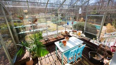 The greenhouse at this Wading River home is