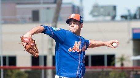 New York Mets pitcher Steven Matz throws a