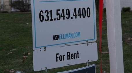A sign advertising a house for rent shown
