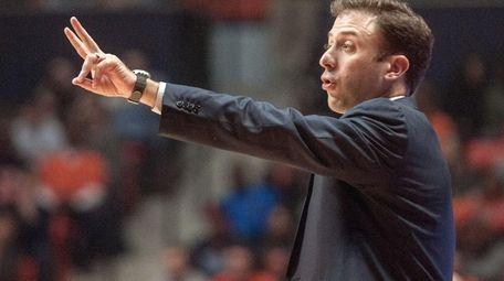 Minnesota head coach Richard Pitino directs his