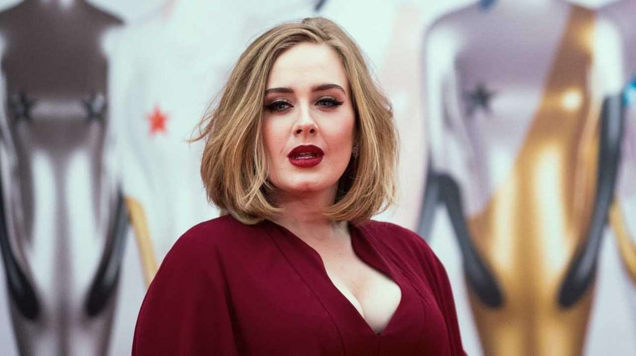 Adele arrives on the red carpet for the