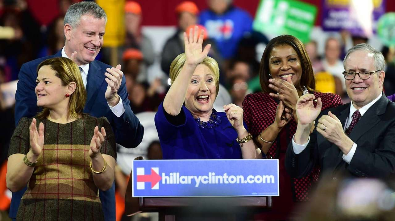 Democratic presidential candidate Hillary Rodham Clinton is surrounded