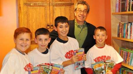 Author Chris Grabenstein poses with Kidsday reporters, from