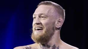 UFC featherweight champion Conor McGregor smiles during open