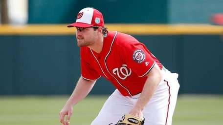 Daniel Murphy #20 of the Washington Nationals fields
