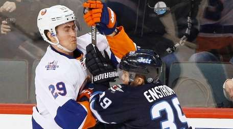 Winnipeg Jets' Toby Enstrom stands up New York