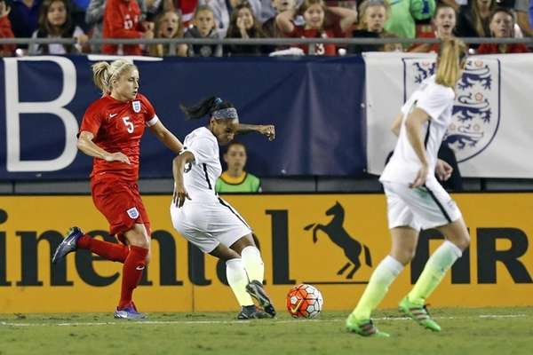 United States' Crystal Dunn, center, shoots to score