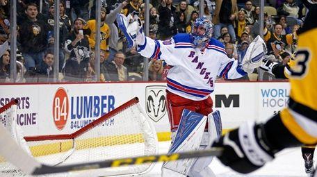 Rangers goalie Henrik Lundqvist gestures to an official