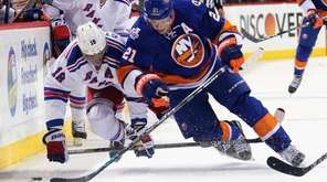 Rangers' Marc Staal trips up the Islanders' Kyle