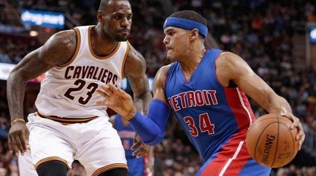 Detroit Pistons' Tobias Harris drives past Cleveland Cavaliers'
