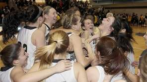 The Commack girls basketball team celebrates their victory