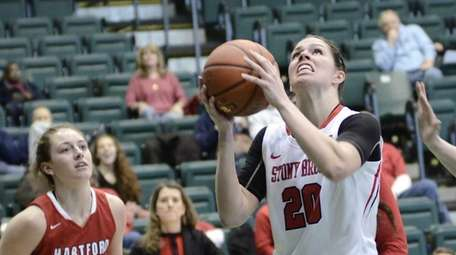 Stony Brook's Brittany Snow, center, lines up a