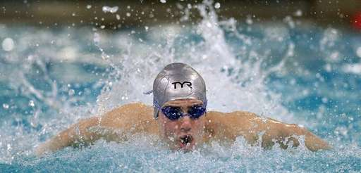 Syosset's Tamir Zitelny swims in the 100-yard butterfly
