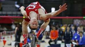 Smithtown East's Daniel Calxton wins the high jump