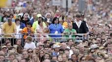 Faithful gathered along Benjamin Franklin Parkway to attend