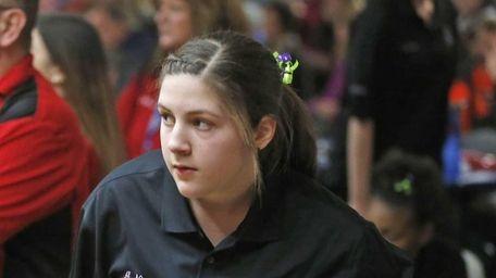 Section XI bowler Amanda Naujokas looks on during