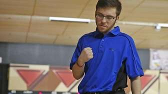 Section XI bowler Adam Zimmerman reacts during the