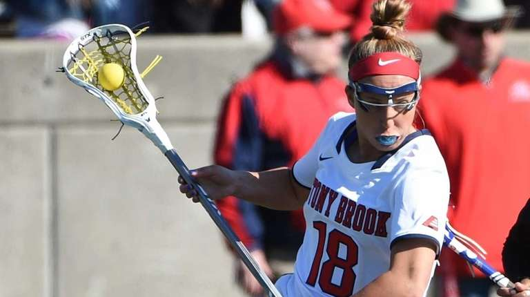 Stony Brook attacker Courtney Murphy is guarded by