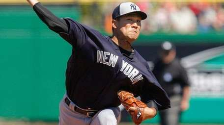New York Yankees' Masahiro Tanaka throws during