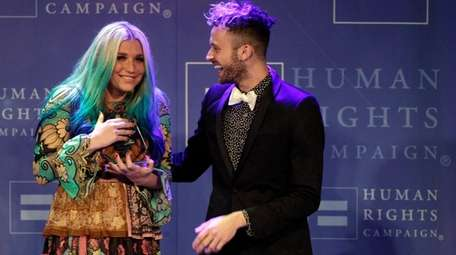 Kesha accepts her Visibility award from fellow performer