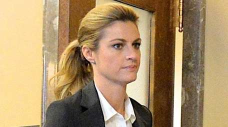 Sportscaster and television personality Erin Andrews walks