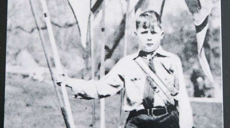 A youth stands at attention at Camp Siegfried