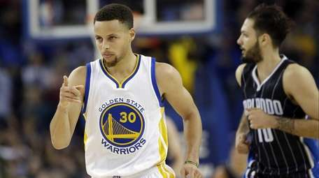 Golden State Warriors' Stephen Curry (30) gestures after