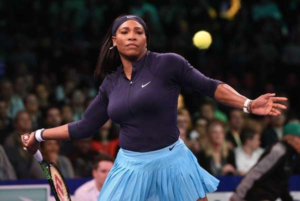 Serena Williams returns to Caroline Wozniacki during the