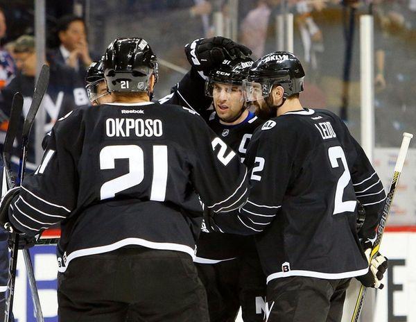 John Tavares, center, celebrates with Islanders teammates after