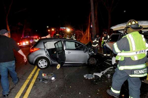 Firefighters respond to the scene of a crash