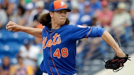 Mets starting pitcher Jacob deGrom throws during