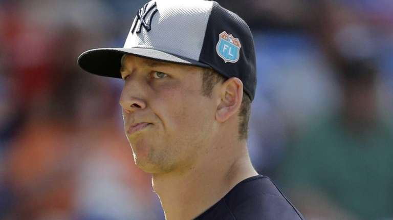 New York Yankees pitcher James Kaprielian heads back