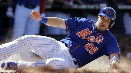 New York Mets' Kevin Plawecki scores on a