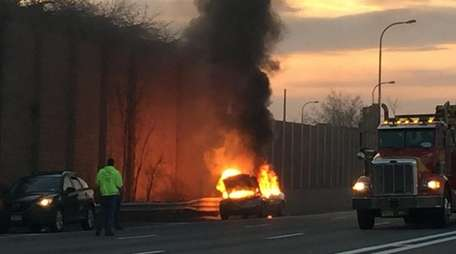 A car fire is seen on the side