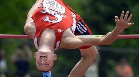 Daniel Claxton clears bar during victory at state