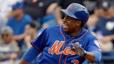Curtis Granderson rounds first after hitting a single